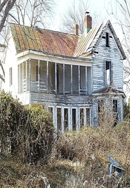 Abandoned house with a second story screened porch.  We have a 2nd story porch that has never been used in the 18 years we've lived here...