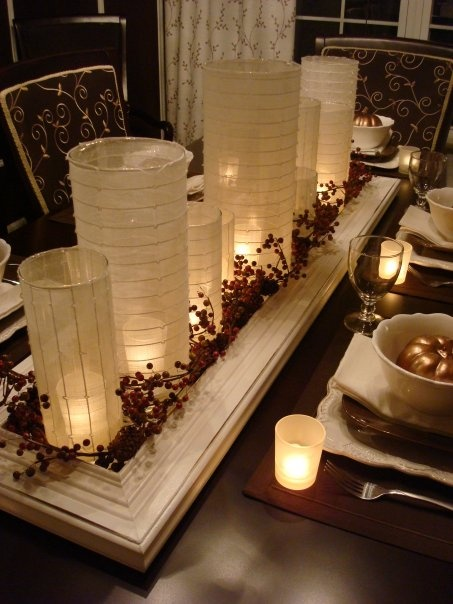 Christmas table add some gold or silver glass ornaments for Dining room centerpiece ideas candles