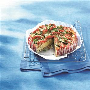 Pancetta-wrapped tomato, courgette and Emmental tart recipe. Impress friends with this colourful lunchtime treat, perfect on a summer's day