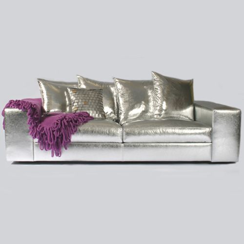 whoah.  crazy silver sofa.....kind of love it.  without the purple blanket, surrounded by neutrals and wood it would be pretty gorgeous.