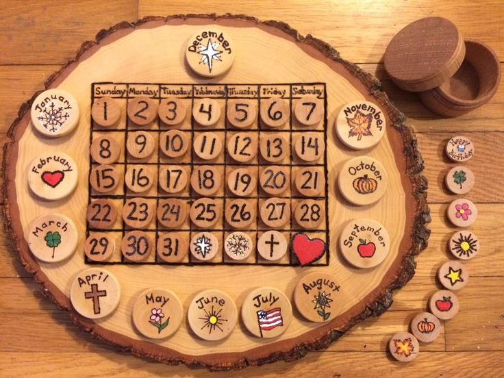 Wooden Calendar: Each wooden slab (with bark) measures approximately 9 X 13. The calendar and wooden discs (attached with Velcro) are hand burned and the holidays are painted and finished with beeswax. Set includes 43 small discs (#1-31 and 12 holiday-your choice) and 12 large depicting months and holidays. A small, round wooden box is a part of the set to store wooden discs that aren't being used. $68.00 set