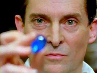 Jeremy Brett as Sherlock examines The Blue Carbuncle  (Granada series)