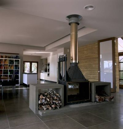 SunpowerDesign-Woodstock Fabulous designed freestanding double sided Cheminees Philippe fireplace with practical wood storage. See more inspiration at www.chemphilaust.com.au