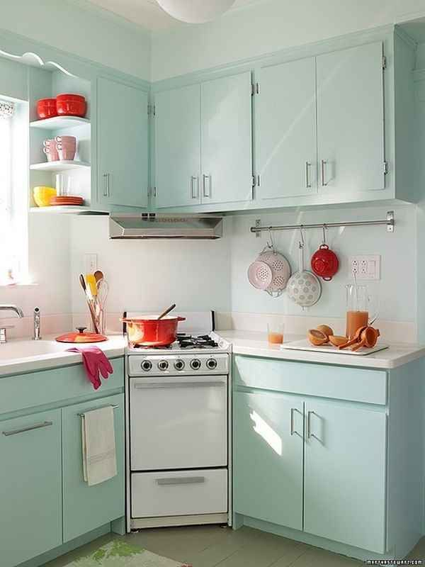 Very crisp, clean greyish/seafoam green kitchen with pops of bright color. Everything looks light and airy and crisp and well-lit/well-ventilated. Kitchen perfection
