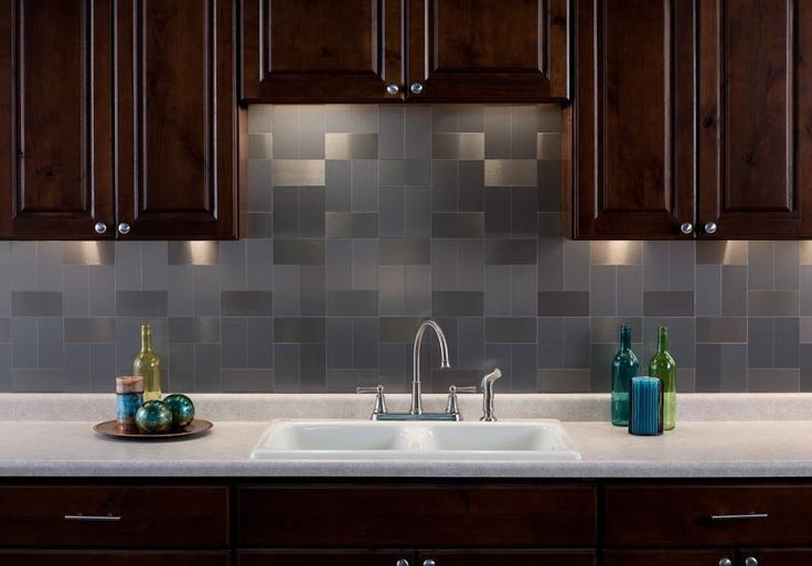 Beautiful backsplash. Who would have guessed these are peel and stick metal tiles?