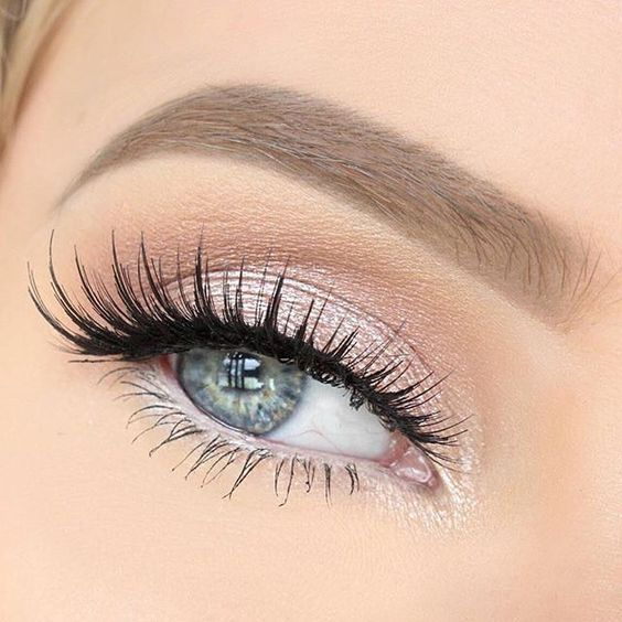 Bridal shimmery pink eyeshadow with eyelash extensions for blue eyes.