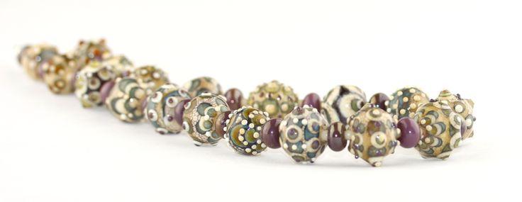Handmade glass beads in organic style
