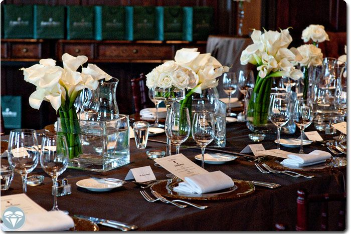 Chocolate brown tablecloth white florals perfectly for Dinner table decoration ideas