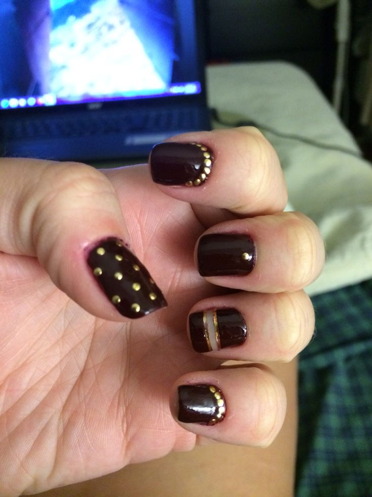Gold and burgundy studded nails