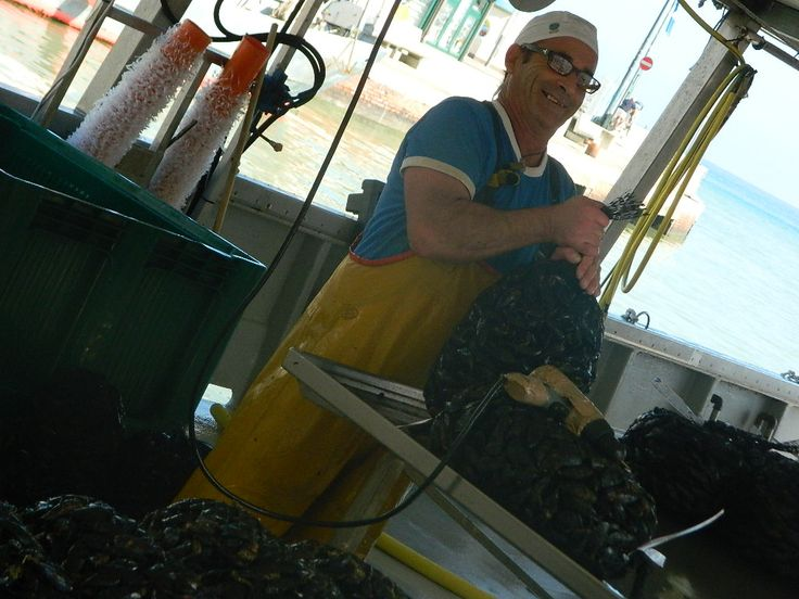 Fresh mussels and a proud fisherman of #romagna! #lovingromagna www.lovingromagna.com