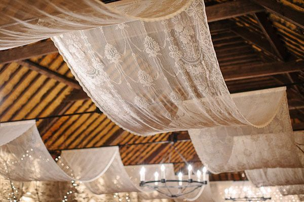So pretty! Overhead white lace wedding decor