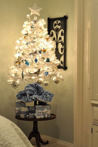 I like this mini tree on a side table with only a few wrapped boxes under it. simple and festive (for those of us that don't have space for a whole tree!)