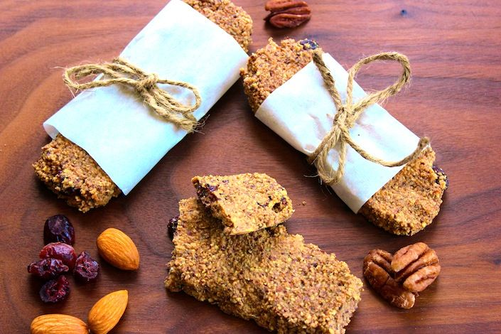 Organic Granola Bars - Gluten & Grain Free      1 1/2 cup cashew meal      1/2 cup pecan meal      2 tbsp packed coconut flour      1 tsp cinnamon      1/4 tsp of unrefined sea salt       1/2 tsp baking soda      3 tbsp Coconut Syrup      1 cup fresh coconut milk      1 tbsp pure vanilla extract      1/2 cup dried cranberries