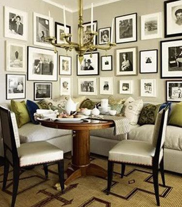 photo gallery wall over kitchen table nook