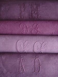 dyed old monogram tablecloth, great idea for linens that have stains.