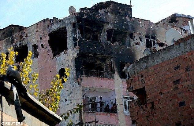 Turkish forces accused of letting 150 Kurds burn to death while trapped in basements as Kurdish 'Freedom Hawks' separatist group claims responsibility for deadly Ankara bombing.