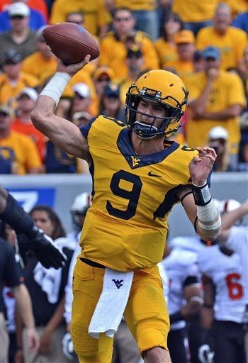West Virginia quarterback Clint Trickett (9) attempts a pass during the first quarter of an NCAA college football game against Oklahoma Statein Morgantown, W.Va., on Saturday, Sept. 28, 2013. (AP Photo/Tyler Evert)