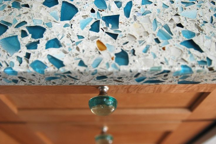 Floating Blue Vetrazzo Maple Cabinets And Recycled Glass
