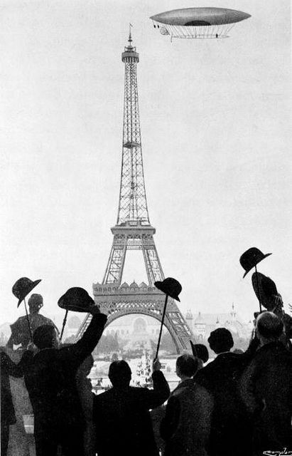 The #6 Airship of Brazilian inventor (and daring pilot) Alberto Santos- DuMont rounds the Eiffel Tower to win the Deutsch Prize, as a crowd cheers, 1901. Jules Verne and H.G. Wells were among the amazed witnesses. (Story and a paper model of the Airship at http://www.fiddlersgreen.net/models/aircraft/Dumont-Airship.html)