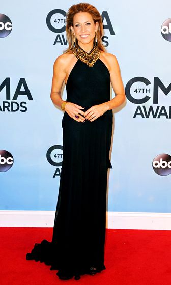 Sheryl Crow in a black floor-length Ralph Lauren gown with a gold-embellished neckline.