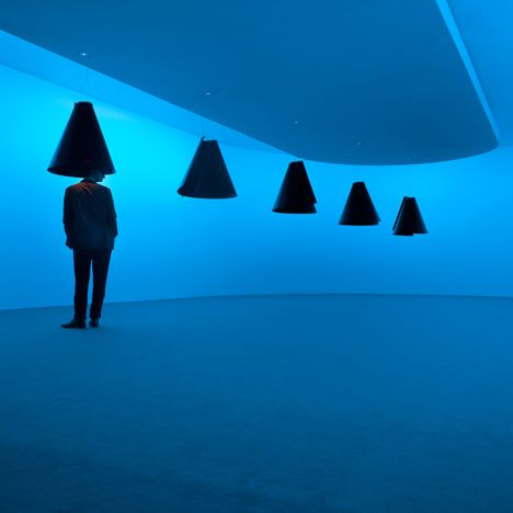 Called Sestosenso, the installation featured conical lamp shades suspended in a white-walled room.