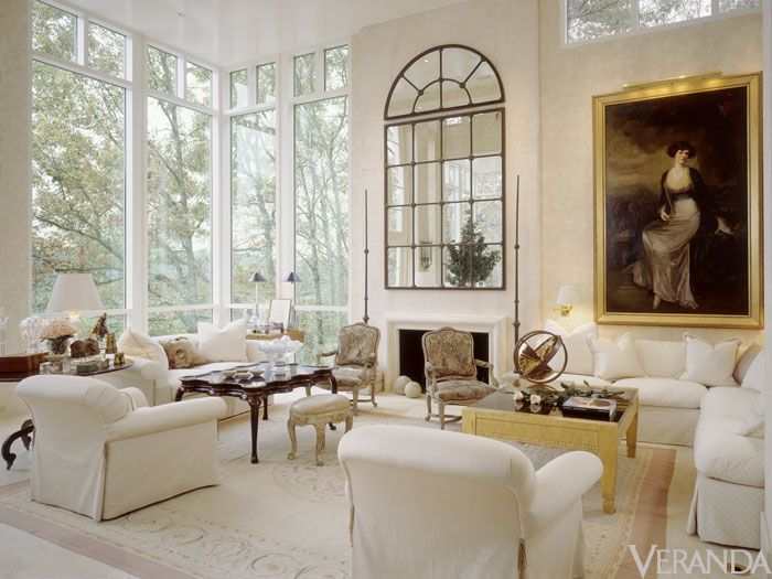 What you leave out of a room is just as important as what you put in it: the absence of curtains and a quiet neutral range keeps Louis XV lines and gilt details current.   - Veranda.com