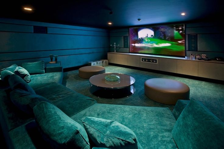 Architecture:Coolest Basement Finishing Ideas With Media Room Basement Remodeling And Home Theater Room Feat Flat Screen Tv And Home Theater Speaker On Vanity With Ceiling Lights And Long Blue Sofas Plus Circle Glass Table And Chairs The Coolest Basement Finishing Ideas for Your On – going Remodeling Basement