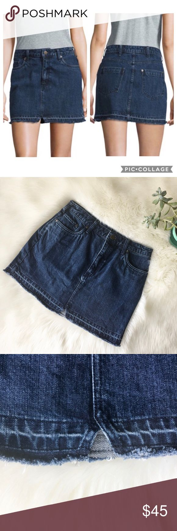 "Free People Step Up Frayed Denim Mini Skirt Dark wash denim mini skirt with zip and button closure, 5 pockets, and frayed hem. Flat waist measurement 14.5"" and 15.25"" long. EUC besides a tiny distressed spot on the waistband next to the button as shown in pic. Sold out online! Free People Skirts Mini"