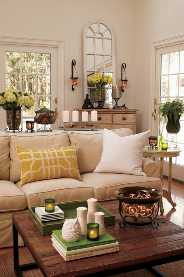 Taupe sofa golden yellow pillow light walls black for Great living room ideas