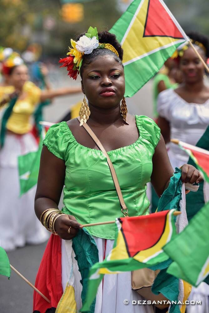 Proud Guyanese woman, Guyana flag.