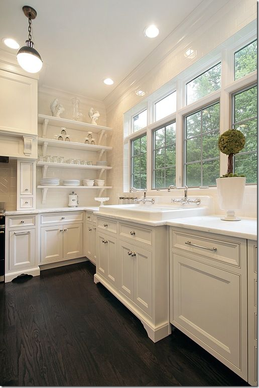 where do I start? white cabinets, dark wood floors, open shelving, subway tile, wall of windows above the sink. Not a fan of the shelves. Must have cabinets.