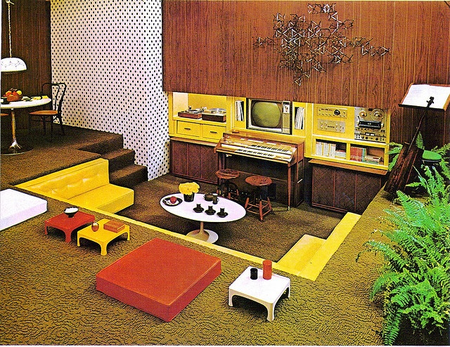 oh man this is AMAZING!! 70's conversation pit. I want to live here and have family dinner nights in front of the tube and then have after dinner song hour around the organ! ^.^