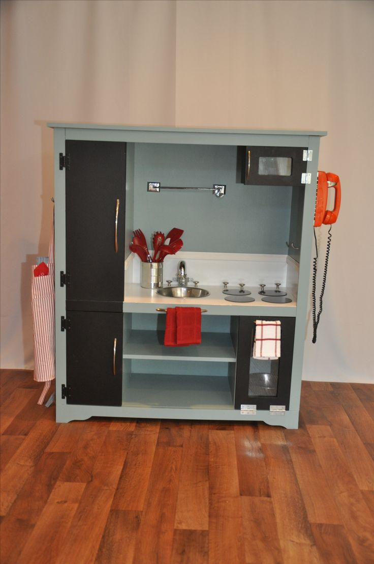Blue kitchen from old entertainment unit, via <a href=