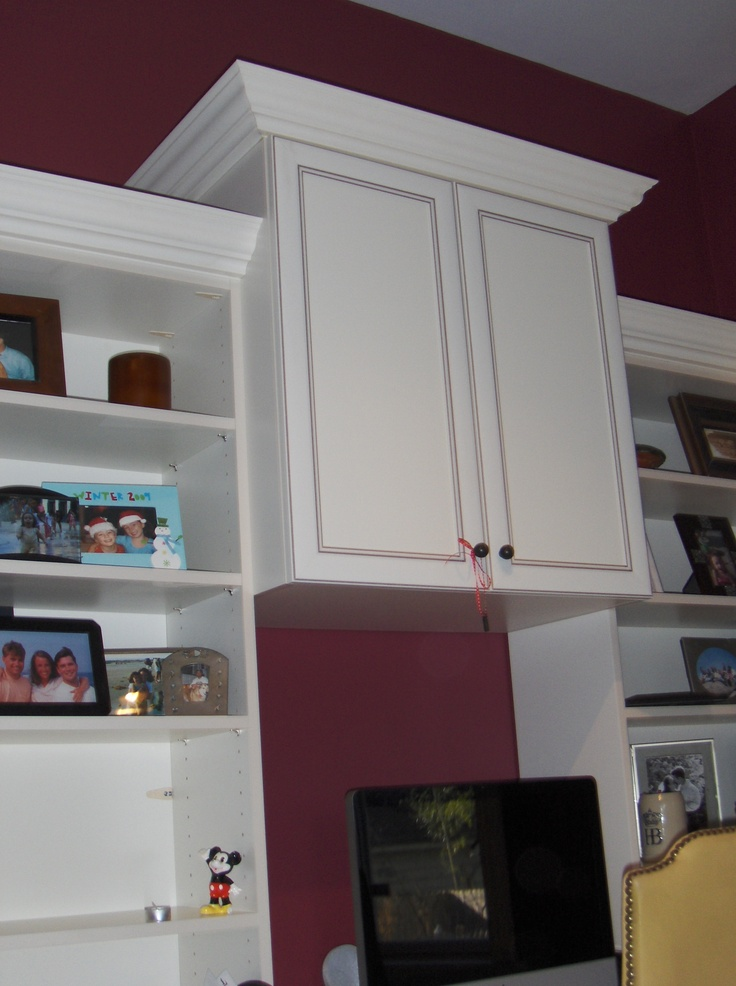 Cabinet OVER your television or computer provides out-of-the-way storage!