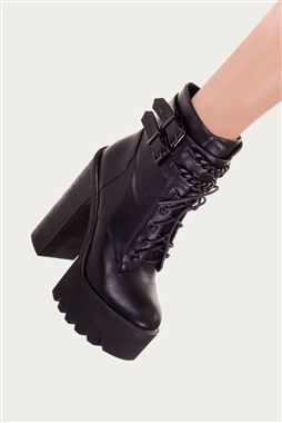 These fierce Gothic boots from Banned are not for the faint hearted! Featuring a wide 6' heel and 2' platform these shoes will help you stand out from the crowds. The traditional style army lace up boot fastens with a side zip and laces ensuring comfort
