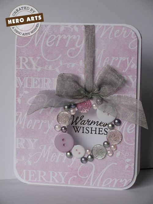 """Christmas card with ribbon, pearls, and buttons made into a wreath with a piece of ribbon made into a wreath that opens to """"Warmest Wishes""""."""