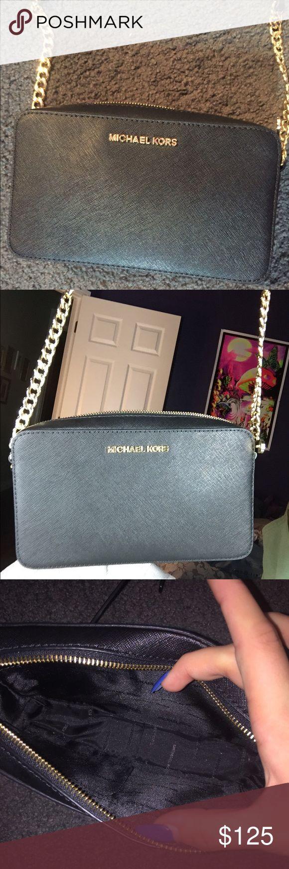 Mickeal Kors Black Crossbody Brand new, NWOT black small crossbody bag. Has long shoulder strap. No stains/scuffs Michael Kors Bags Crossbody Bags
