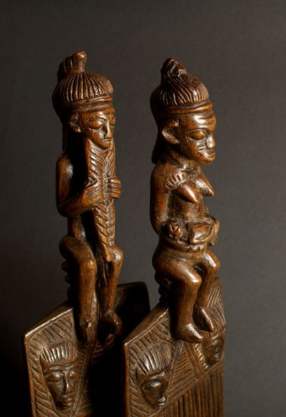 Africa | Details on the top of hair combs from the Baule people of the Ivory Coast