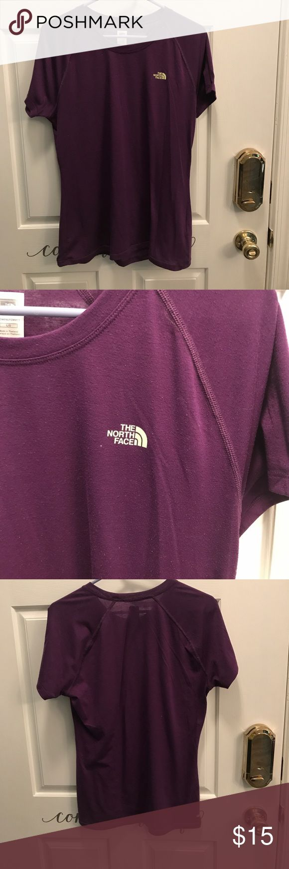 The north Face shirt Vapor wick material. Women's size large. Purple with yellow detail on chest. EUC The North Face Tops Tees - Short Sleeve