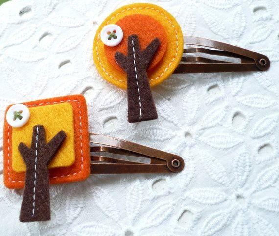 Horquillas de arbolitos en fieltro amarillo, naranja y marrón