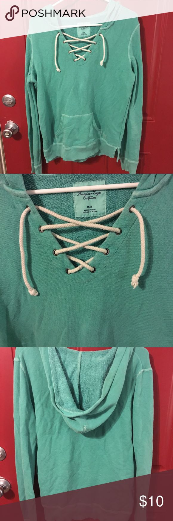 American Eagle lace up hoodie American Eagle lace up hoodie, has very small hole. Photo shows hole. American Eagle Outfitters Tops Sweatshirts & Hoodies