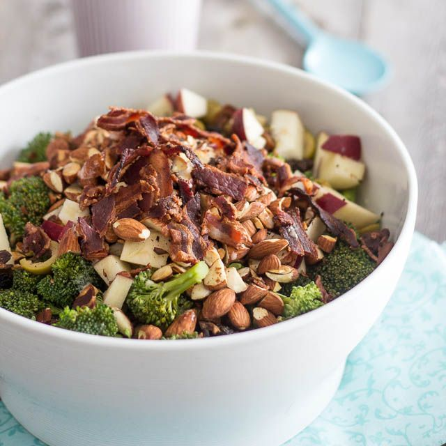 Broccoli Apple and Almond Salad with honey Dijon mustard dressing...a combination of diced red apple, chopped almonds, sliced green olives, raisins, chopped dates and crispy bacon drizzled with a honey mustard dressing