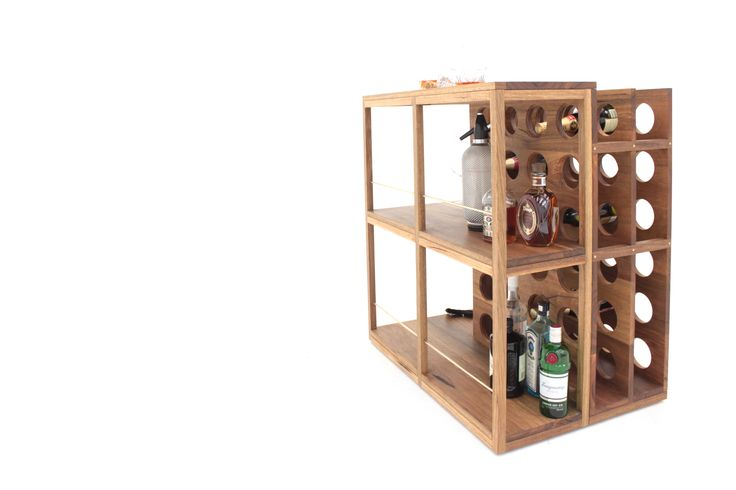 Plonk Bar is a drinks storage unit-meets-cocktail bar and wine rack. With styling out of the 1960s, it wouldn't look out of place in Don Draper's living room. The piece is mounted on concealed, recessed castors which allow for the bar to be easily rotated or moved - the ultimate mobile drinks station.   At 900mm high, it is the perfect height to mix cocktails, serve whiskey over ice or open a nice bottle of Chianti to let it breathe.    #sawdustbureau #furniture #design #melbourne #art