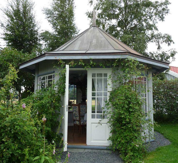 Enclosed Gazebo Creates a Lovely Garden Hideaway…