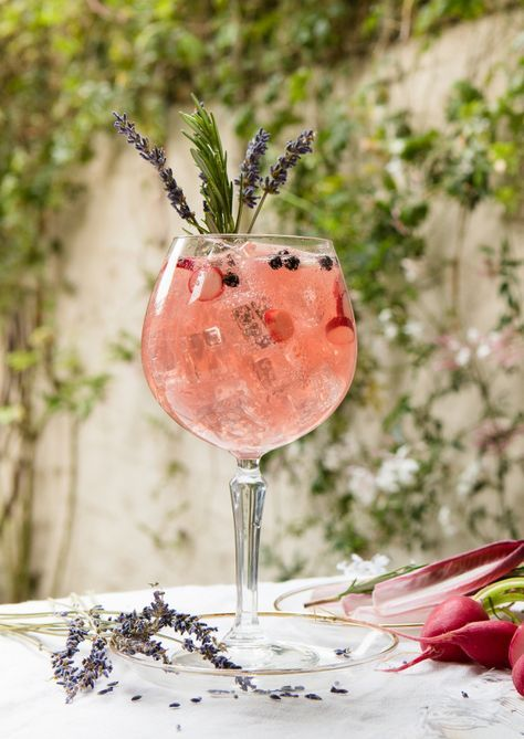Parties with guests who expect food, fun and one thing only when it comes to booze. That's right – gin. You could stick to classic gin and tonics and, if you do so, why not try prettying them up with big twists of pink grapefruit peel and juniper berries as above? Some new gin recipes for your summer garden parties this year.