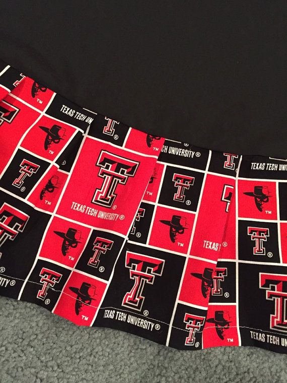Approximately 56 wide Christmas tree skirt with Texas Tech ruffle. Ruffle is hemmed. Skirt base may be white (as shown), red, or black--your choice. Also, request velcro or tie/bow closure. Email me for your custom order specifications. Perfect addition to your Christmas tree for Red Raider fans