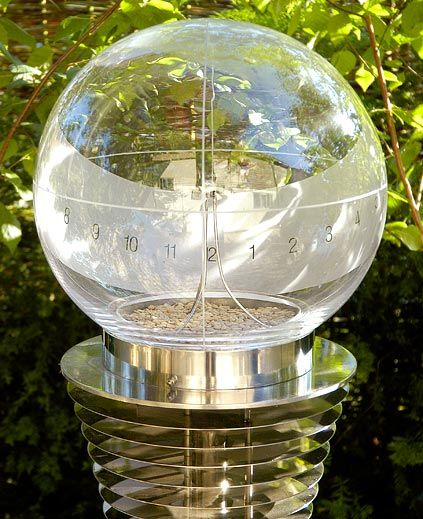 Andromeda-Hand blown glass globe, which function as a sundial, is mounted on a column of stainless steel discs with water running down the centre.