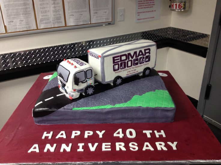 Box truck cake made for EDMAR janitorial a 40 th anniversary. The entire truck is edible made of rice crispy treats and fondant.