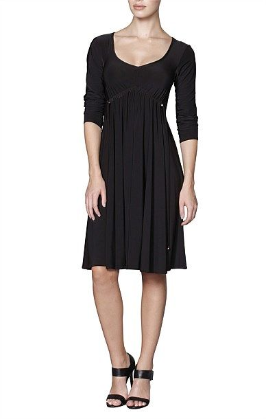 Shop Solutions - GATHERED EMPIRE SCOOP NECKLINE KNEE LENGTH JERSEY DRESS IN…