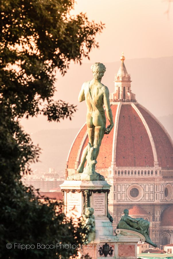 Florence symbols, Michelangelo's David and Duomo cathedral at sunset, Italy *
